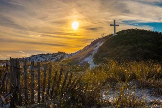 A beautiful sunset highlighting the cross that we can find our true joy from through Christ's death and resurrection.