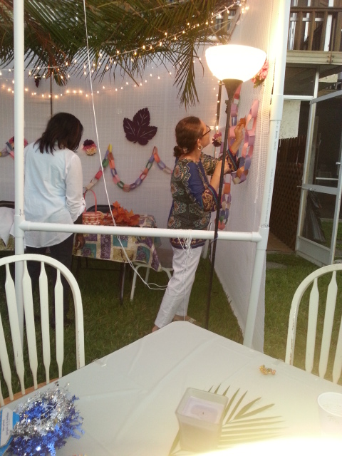 adding decorations to the sukkah
