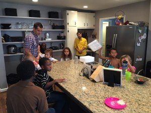 Dinner time is QUITE full as 11 kids gather around the kitchen island.
