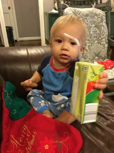 Judah loving the stocking stuffers. (we don't get juice boxes much in this house)