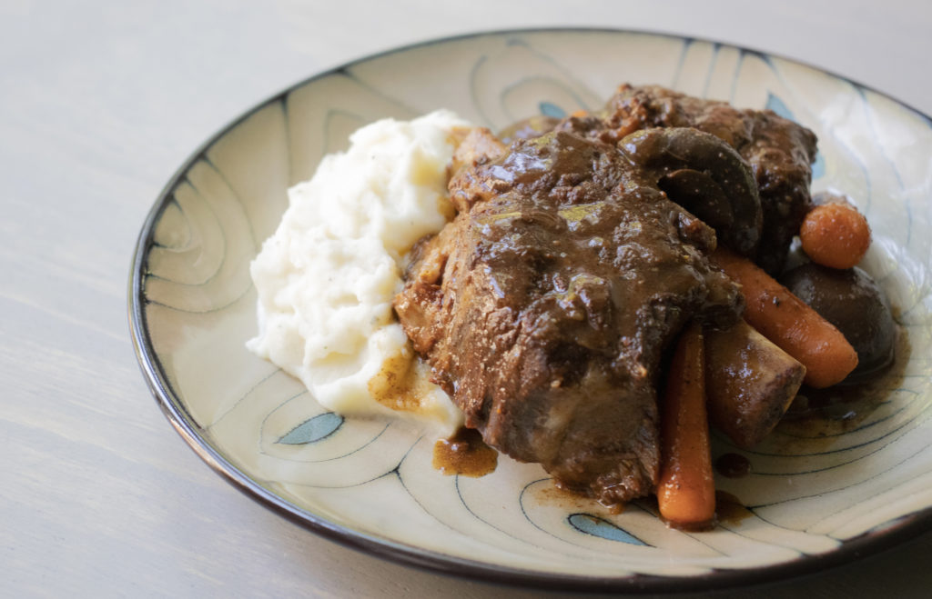 Short ribs with carrots and mashed potatoes.
