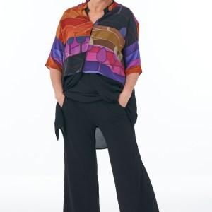 Black trousers bright silk crop tunic