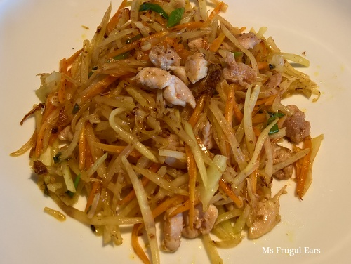 Stir-fried chicken with green papaya and Vietnamese mint