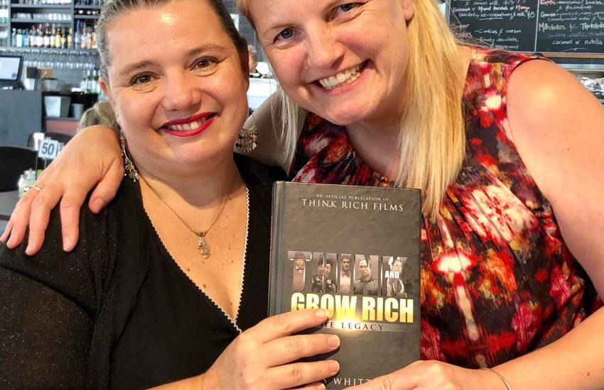 Serina and Jody with a copy of Grow Rich The Legacy