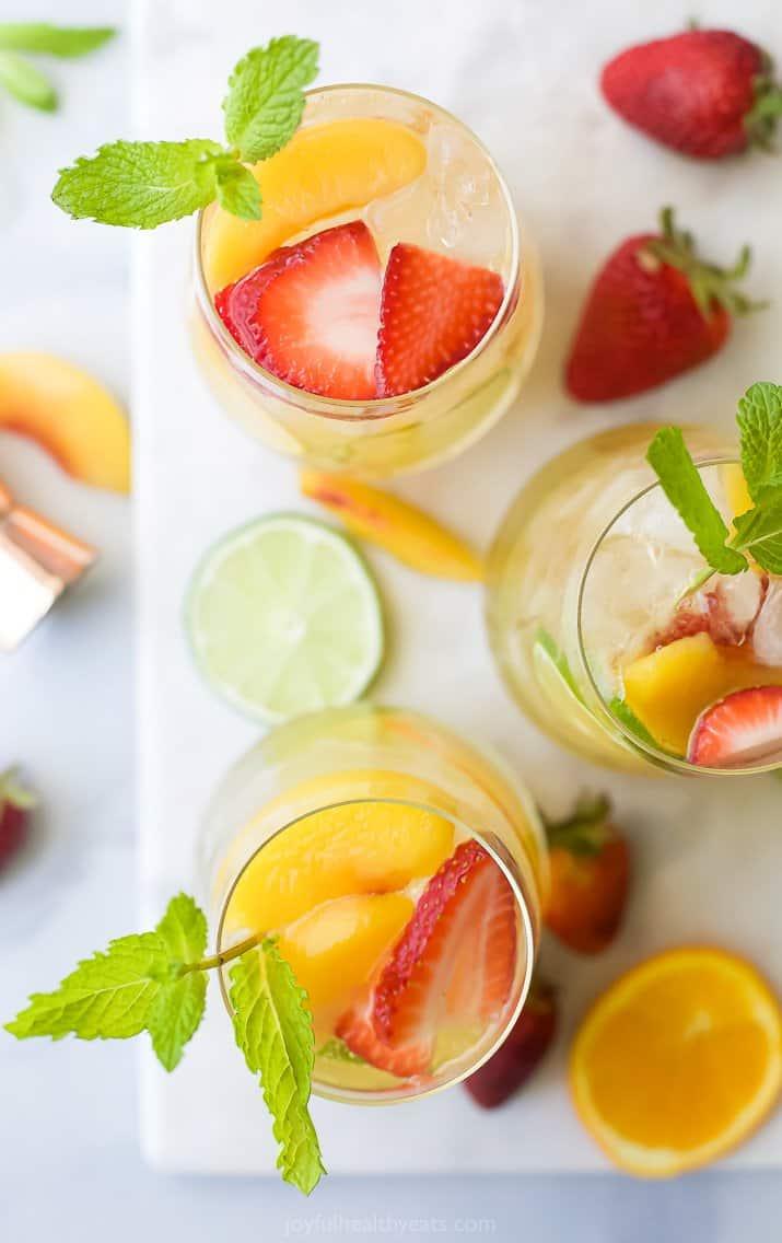 overhead photo of strawberry peach moscato sangria in wine glasses