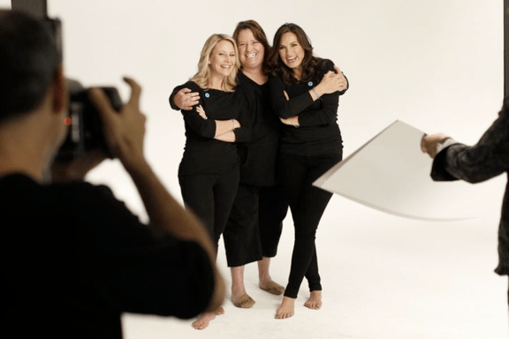 The creative team: Joyful Heart CEO Maile Zambuto, Creative Director Rachel Howald and Director Mariska Hargitay pose for campaign photographer Timothy White.