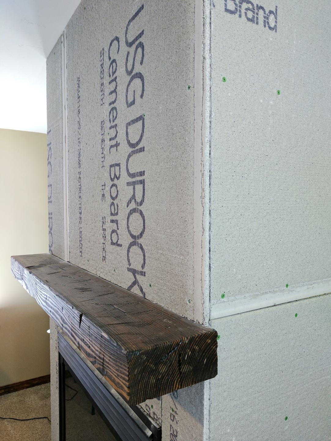 DIY Distressed Wood Beam Mantle - How to perfectly distress wood to make it look old.