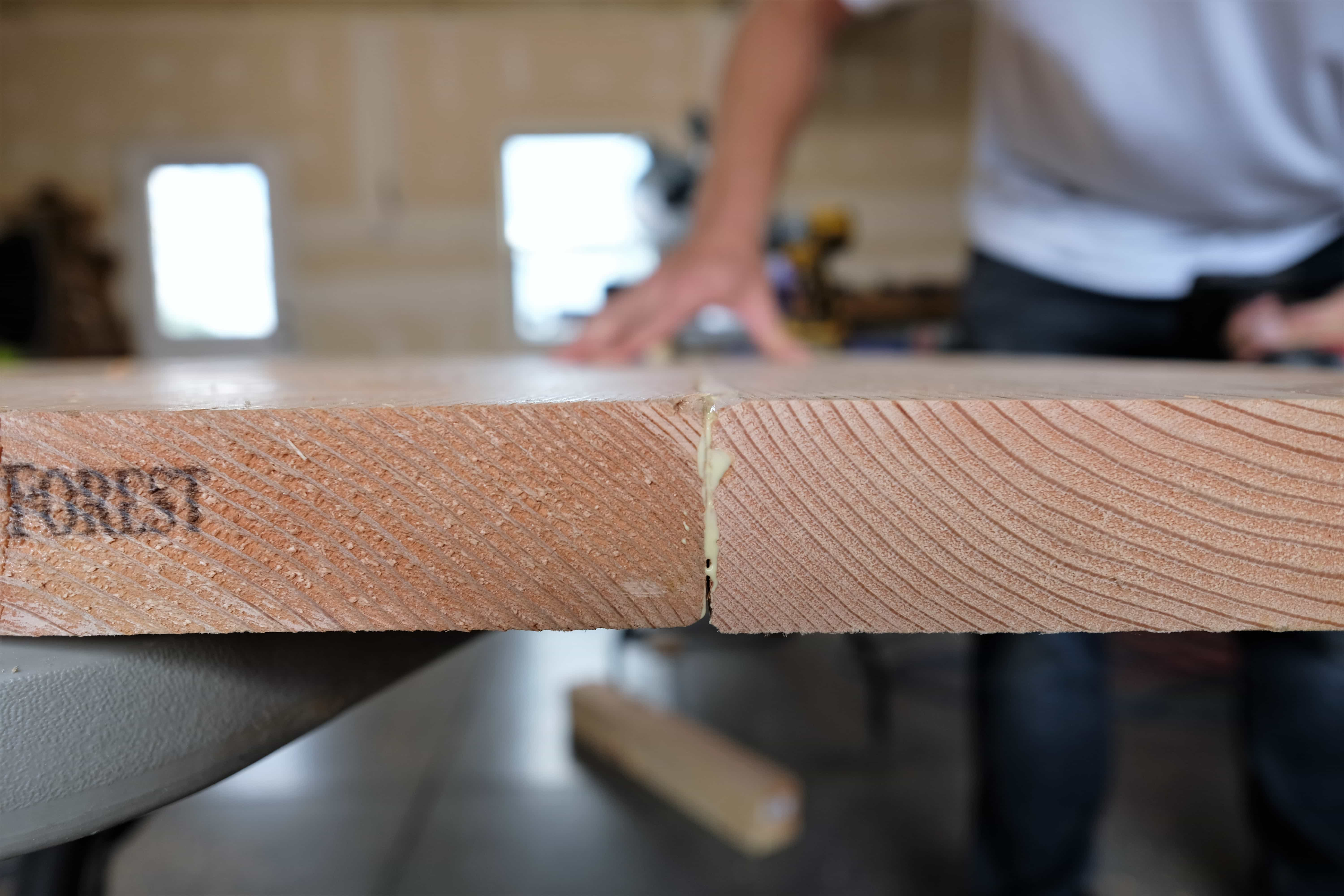 gluing boards together to make rustic coffee table