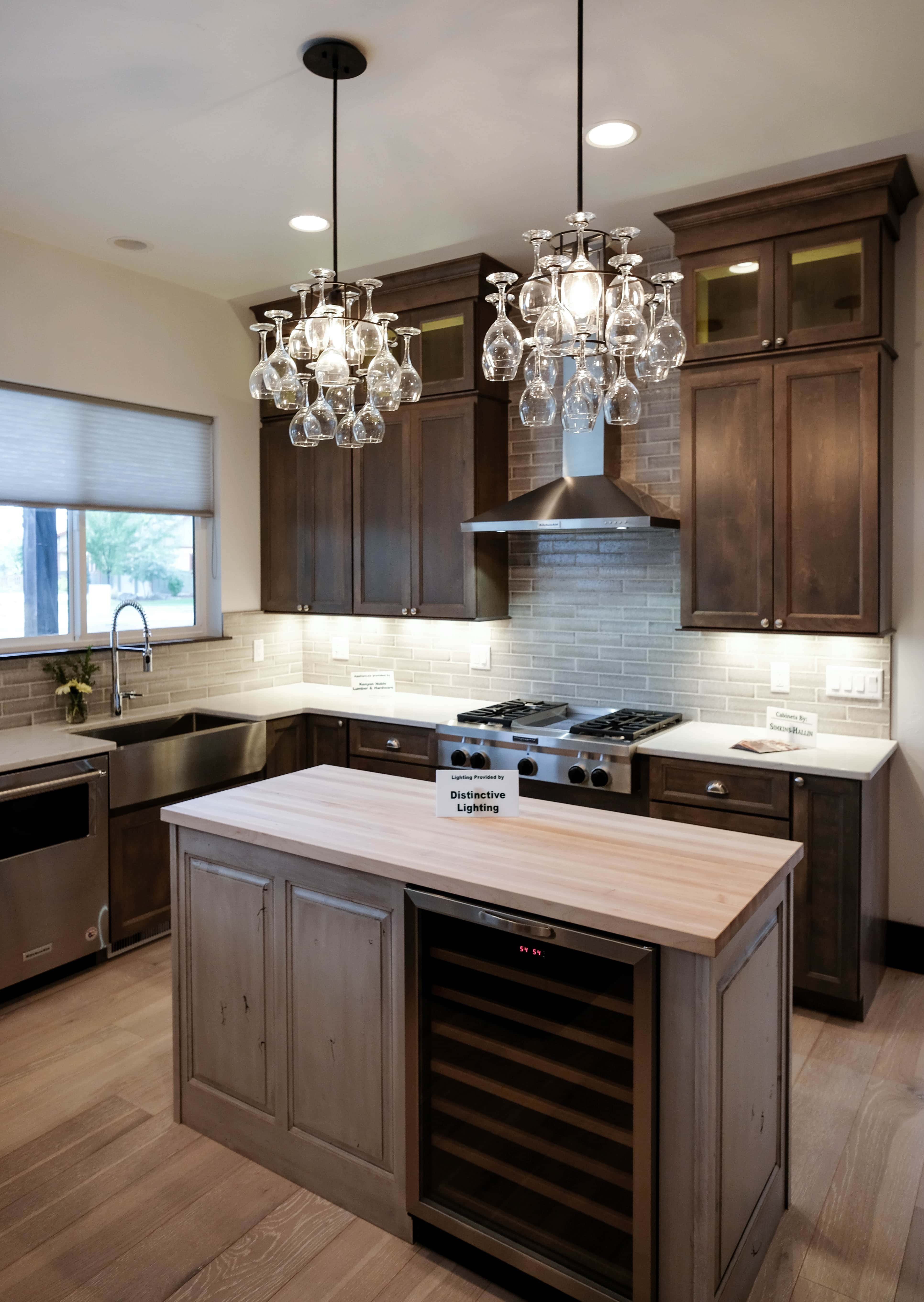 Parade of Homes designer kitchen with dark cabinets, and butcher block island