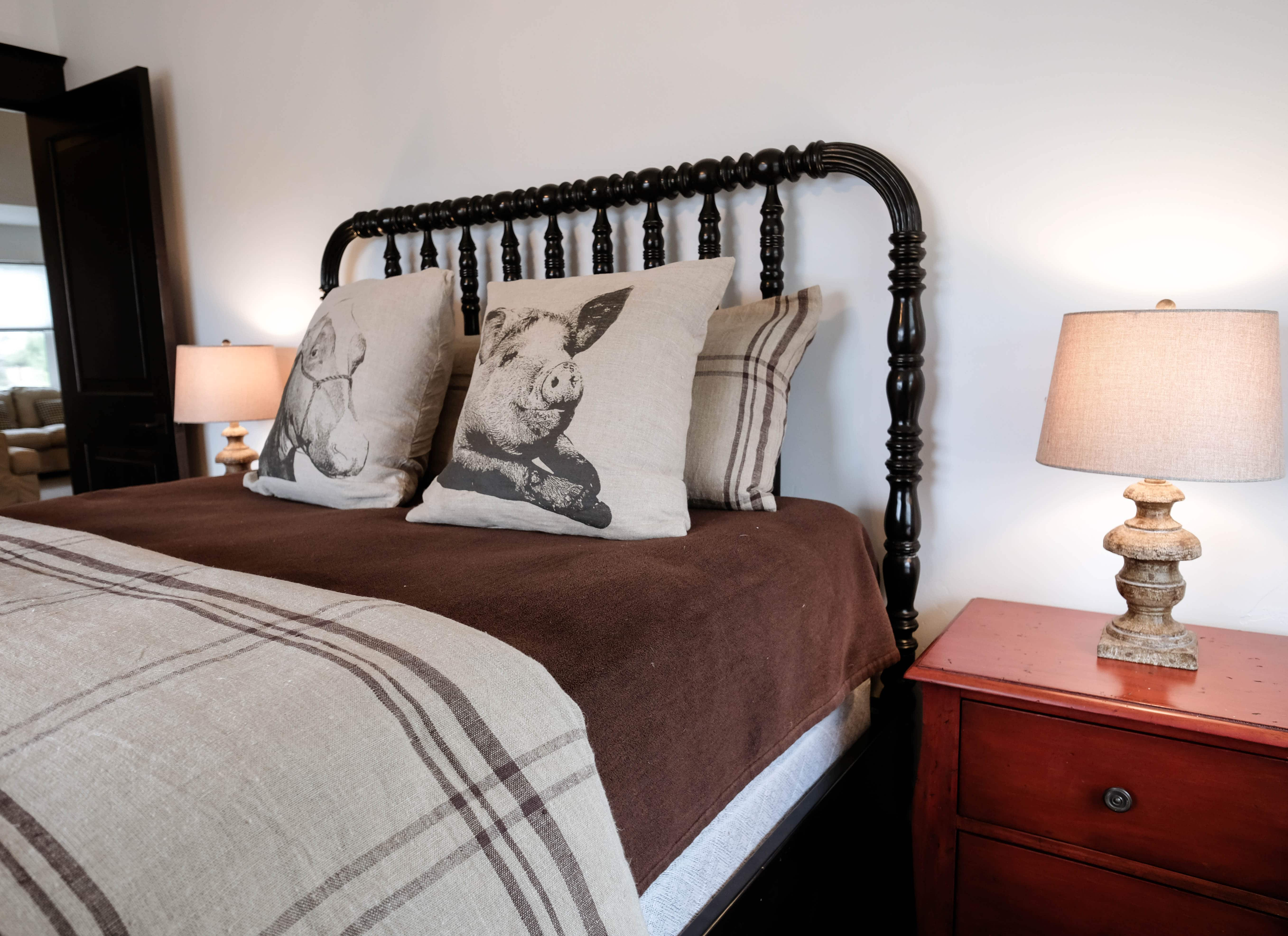 Parade of Homes bedroom with wooden headboard, nightstands and lamps