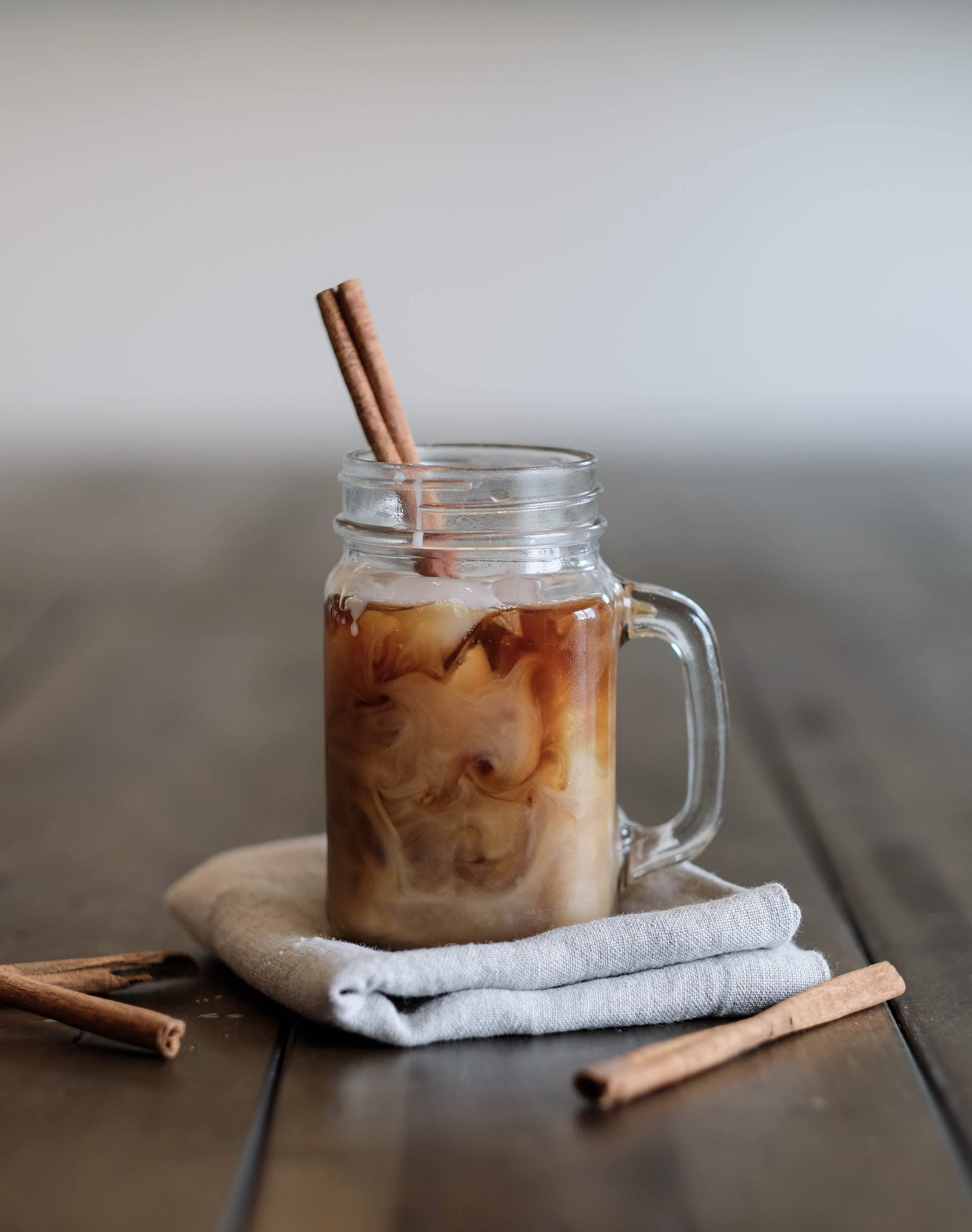 Cold Brew Coffee with Homemade Coffee Syrup in a mason jar with a cinnamon stick