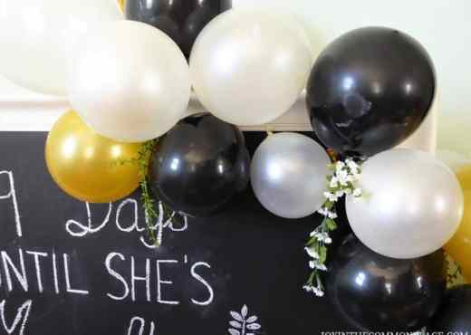 Black & Gold Balloon garland & florals