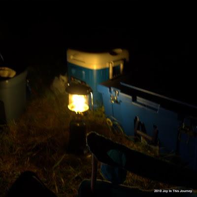 lantern at campsite at night