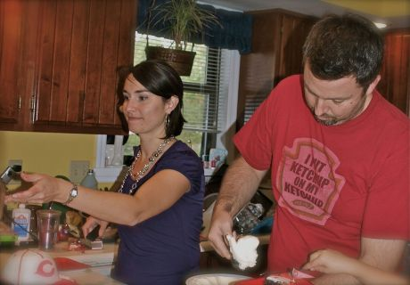 Scott and Joy serving cake