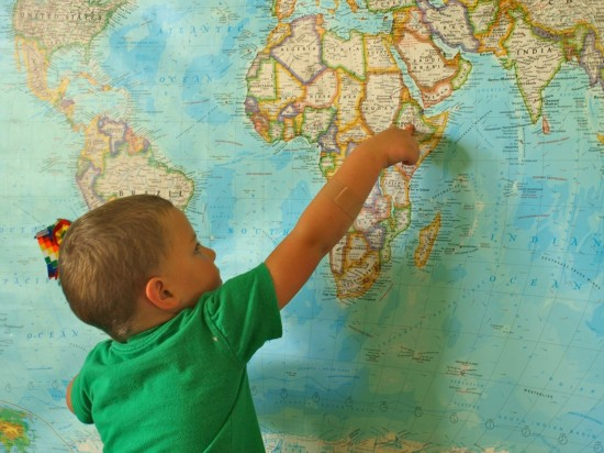 son pointing to map in dining room