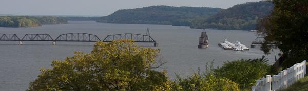 Photo of barge and open railroad bridge