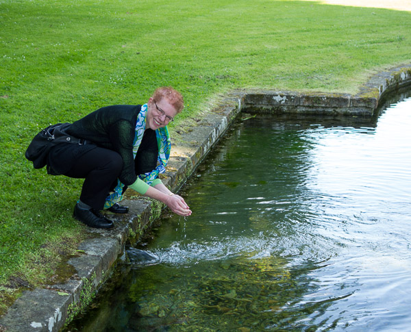 photo of me drinking water from a spring