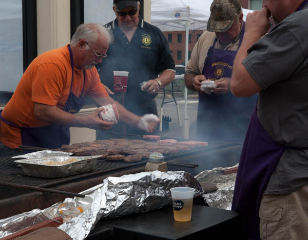 photo of men grilling pork burgers