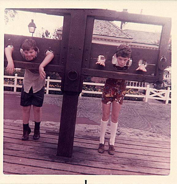 Two children in stocks, Disney World, 1973