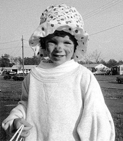 little girl in floppy hat and oversized sweatshirt