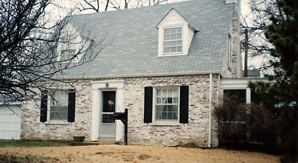 whitewashed brick Cape Code style house