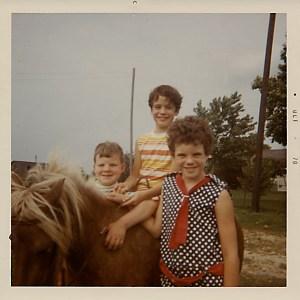 Three children and a pony