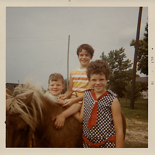 Three children and a pony