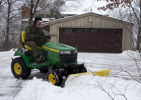 Rick on tractor with snow plow blade attachment