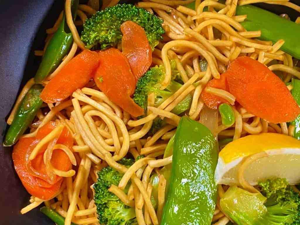 Filipino Vegetable Pancit in a black bowl