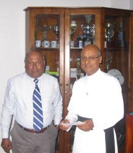 Fr. Travis with Upali