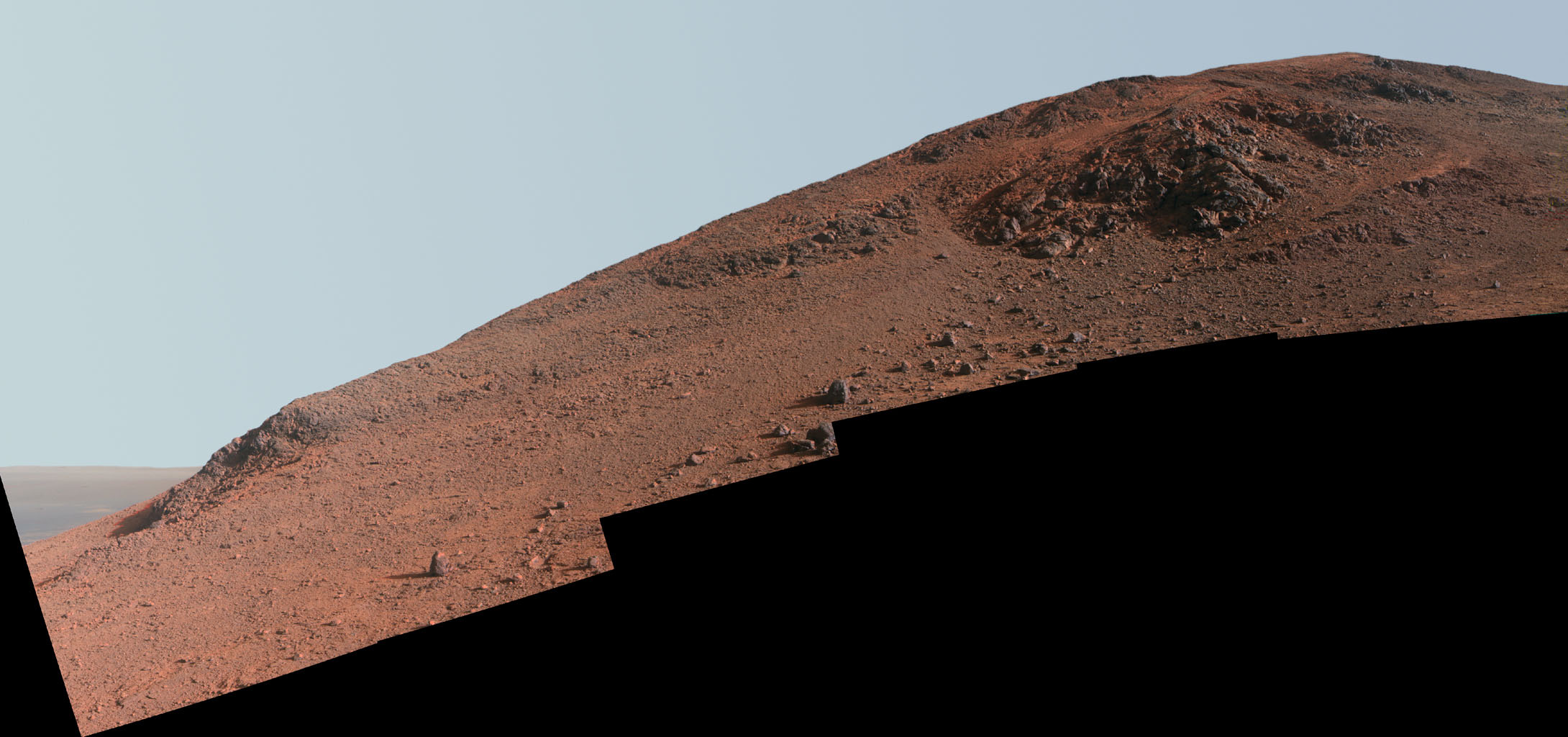 This scene from NASA's Mars Exploration Rover Opportunity looks upward at