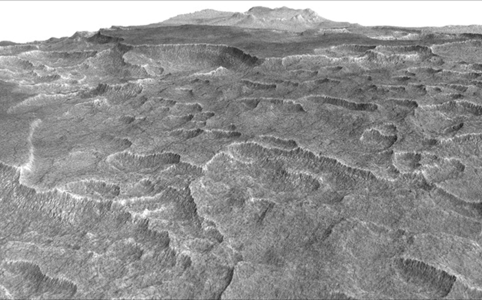 This vertically exaggerated view shows scalloped depressions in Mars' Utopia Planitia region, one of the area's distinctive textures that prompted researchers to check for underground ice, using ground-penetrating radar aboard NASA's Mars Reconnaissance Orbiter.