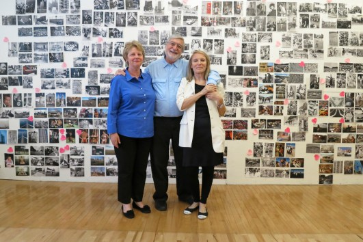 """June 24th, 2013. NYC Laffont studio: left to right Marta Hallett, CEO of Glitterati Inc, JP and Eliane Laffont in front of the selected photos of the """"Photographer's Paradise"""" book."""