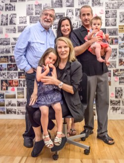 June 25, 2013. Manhattan, New York. JP Laffont and his wife Eliane, their daughter Stephanie with her partner, and their grand-children Silvie and Spirrow in front of 'Photographer's Paradise' book wall.
