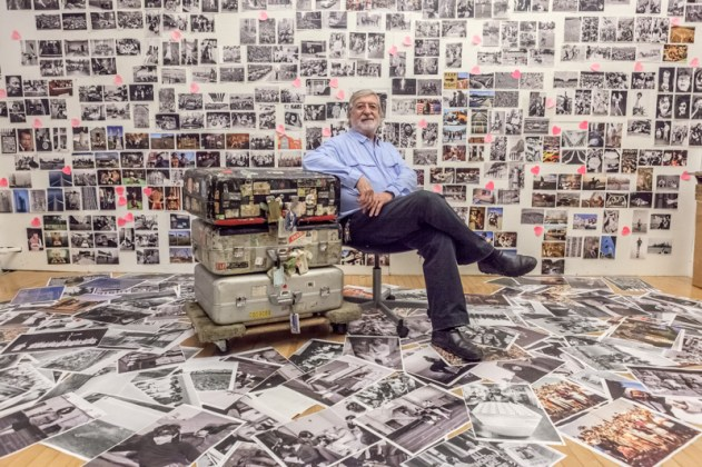 June 25, 2013. Manhattan, New York. JP Laffont in front of 'Photographer's Paradise' book wall.