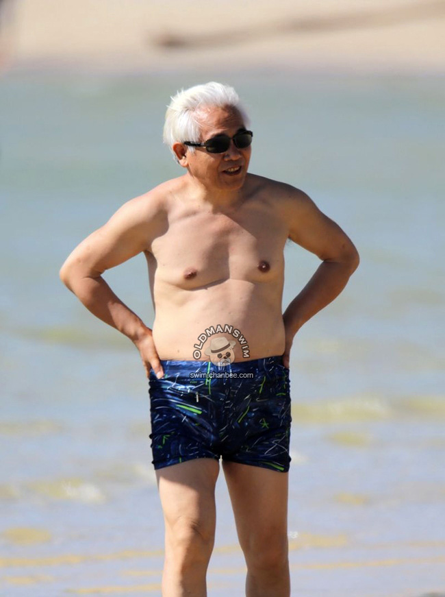 Belly Old Man And White Hair Old Man Standing On The Beach