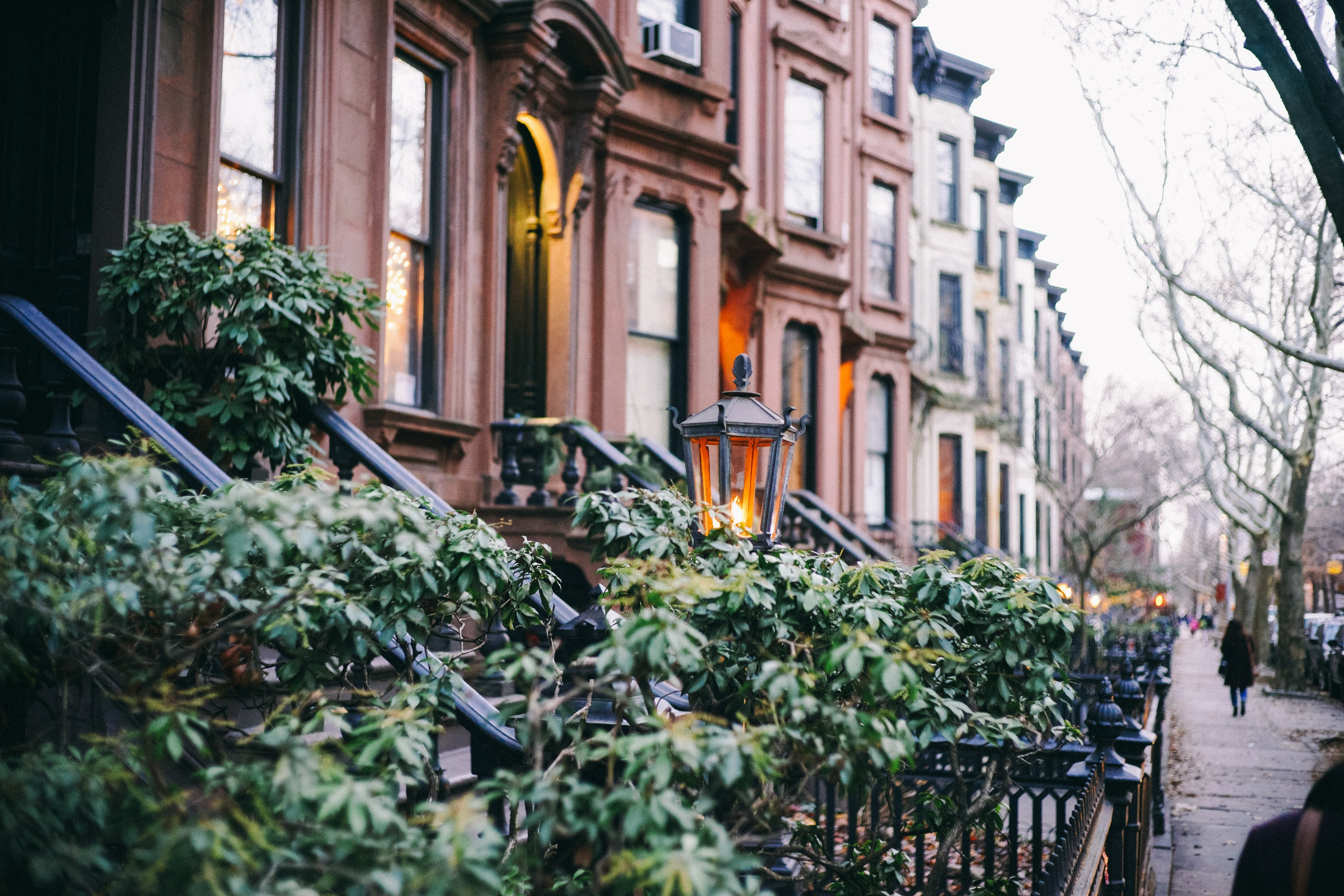A close up on a row of buildings with lush greenery. With the right Park Slope movers, one of those doors could be yours!
