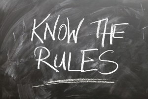 """a blacboard with written """"know the rules"""""""