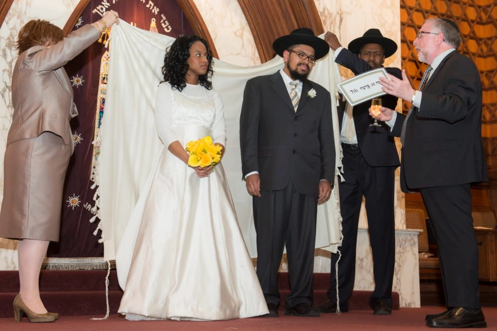 Rabbi Simon Benzaquen recites the sheva brachot at the wedding of Chana and Yosef Brown in Seattle, March 5, 2013. (Meryl Alcabes)