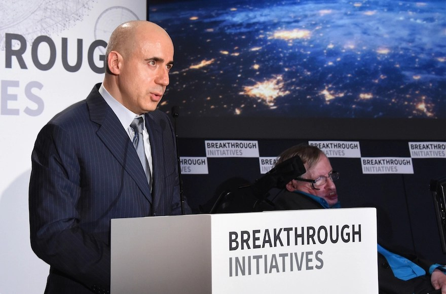 Yuri Milner, left, and Stephen Hawking attending a press conference on the Breakthrough Life in the Universe Initiatives, July 20, 2015, in London, England.  (Stuart C. Wilson/Getty Images)