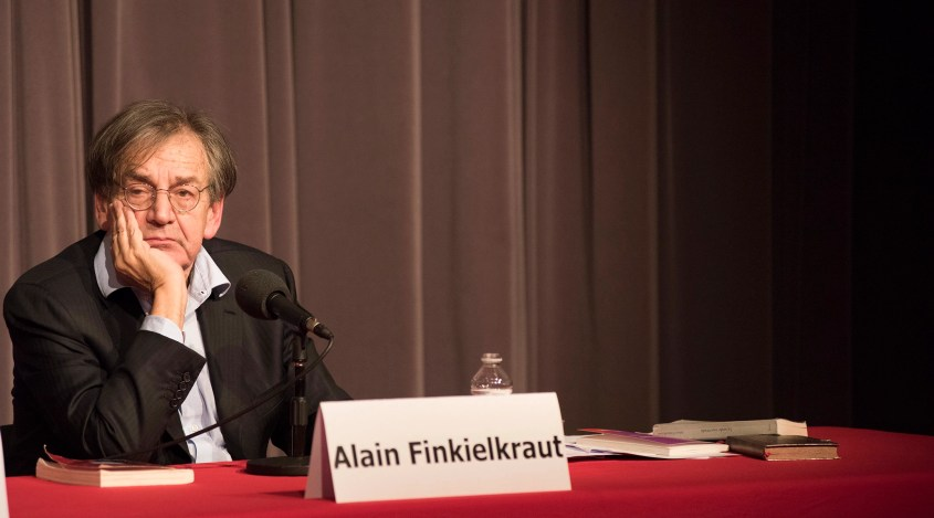 Alain Finkielkraut preparing to answer a question at an appearance in Brussels, Belgium on April 3, 2016. (Cnaan Liphshiz)