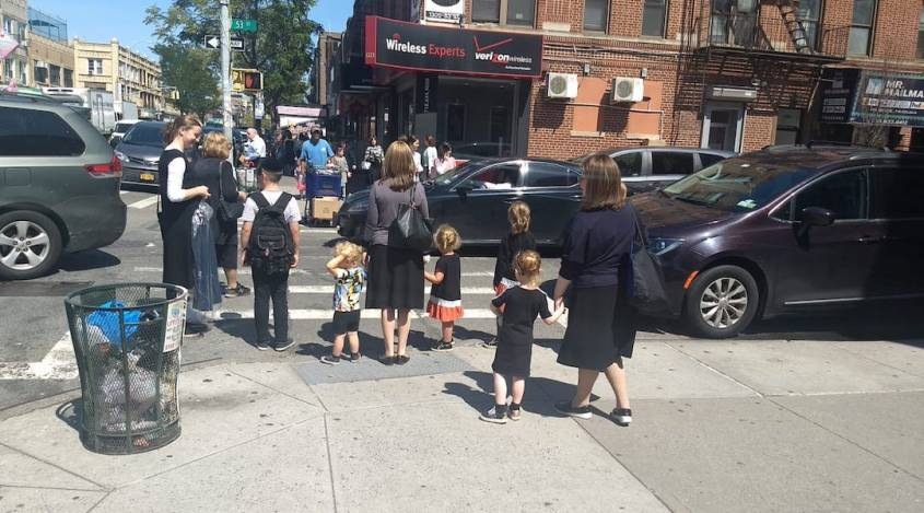 Women and children wait at a crosswalk in the Orthodox neighborhood of Borough Park, Brooklyn on Tuesday, September 3. (Ben Sales)