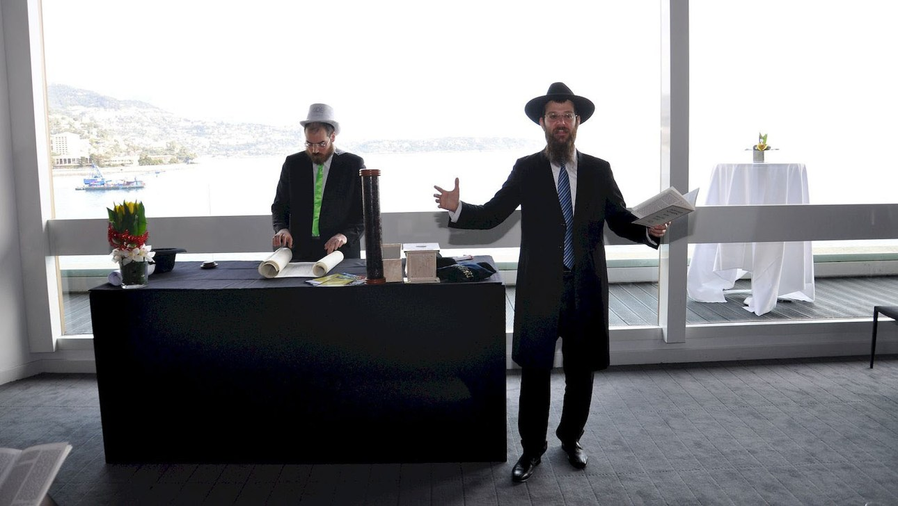 Rabbi Tanhoum Matusof reads from the Book of Esther on Purim in Monaco on Feb. 28, 2018. (Courtesy of the Jewish Cultural Center of Monaco)