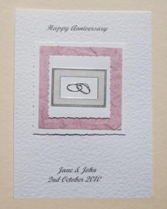 Rings On Old Rose Anniversary Card Front - Ref P120