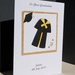 Black Gown with Yellow Trim Graduation Card Angle - Ref P145y