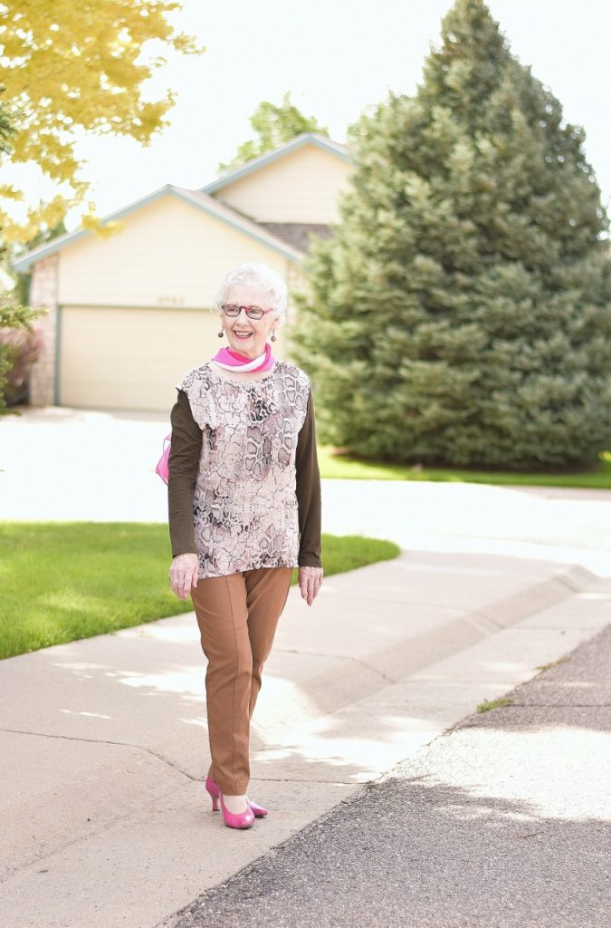 Women over 70 wearing blush and olive green
