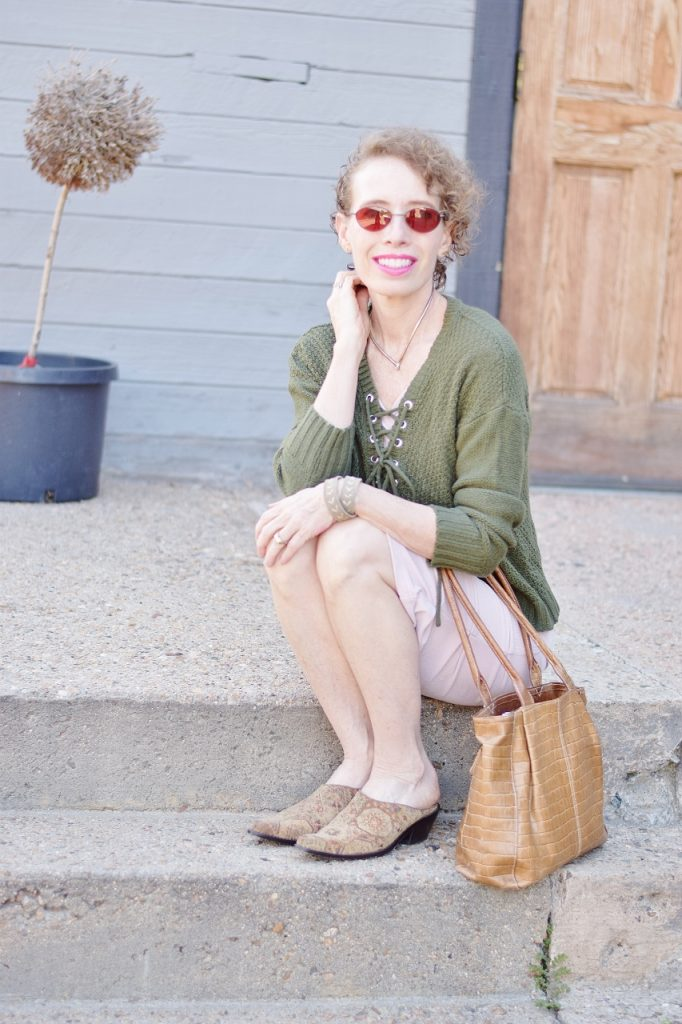women 50+ wearing blush and olive green