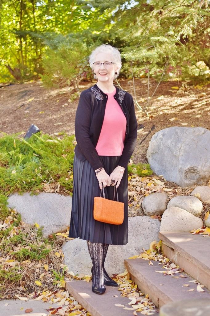 Women 70+ wearing Orange and black