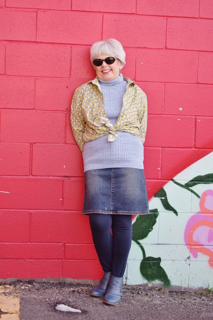 RockFlowerPaper and woman over 60 wearing a blouse
