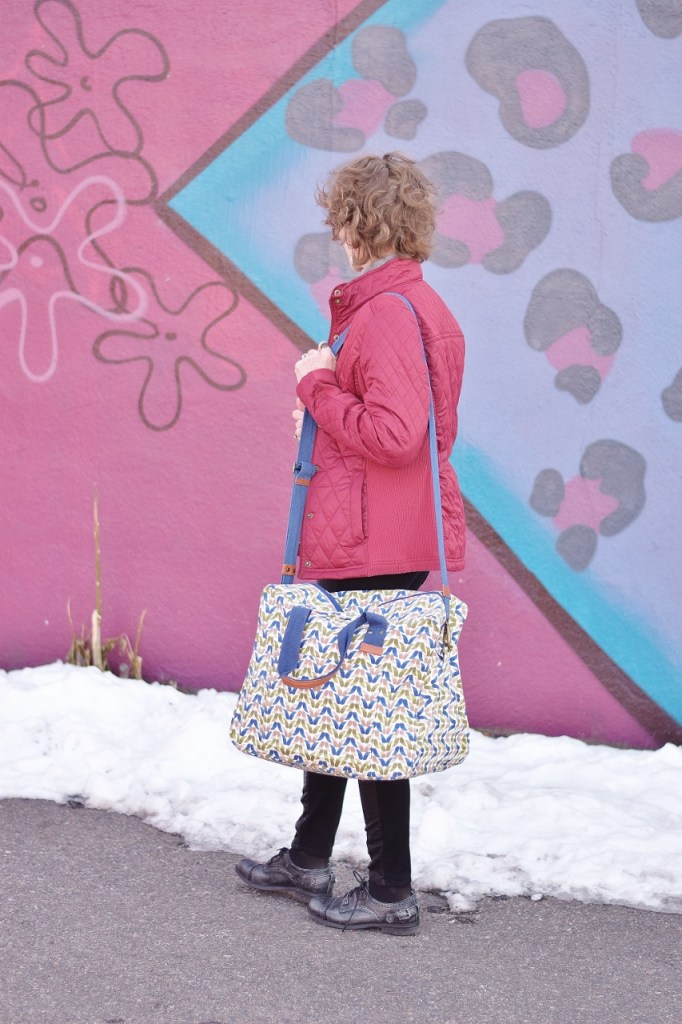 RockFlowerPaper and woman over 50 with an overnight bag